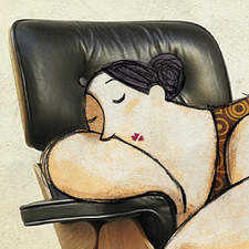 Sleeping woman on armchair photography