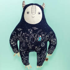 This is a toy inspired in the moon and the night , it has fotoluminiscense ink and glows in the dark . It accompanies children who are afraid of the dark.