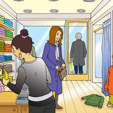 Shop interior with Mother and children shopping for clothes
