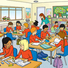 classroom with multi-ethnic primary age children with teacher