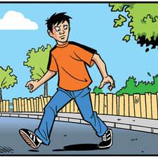 Pre-teen boy walking across a road