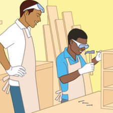 Afro Caribbean boy making bookshelves at school.