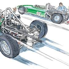 Early Lotus Formula One racing single seat car leaves pits, driver waves to mechanics working on another car.