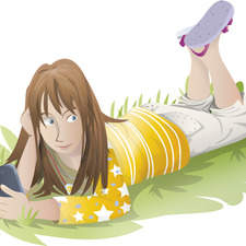 Teenage girl laying on the grass.